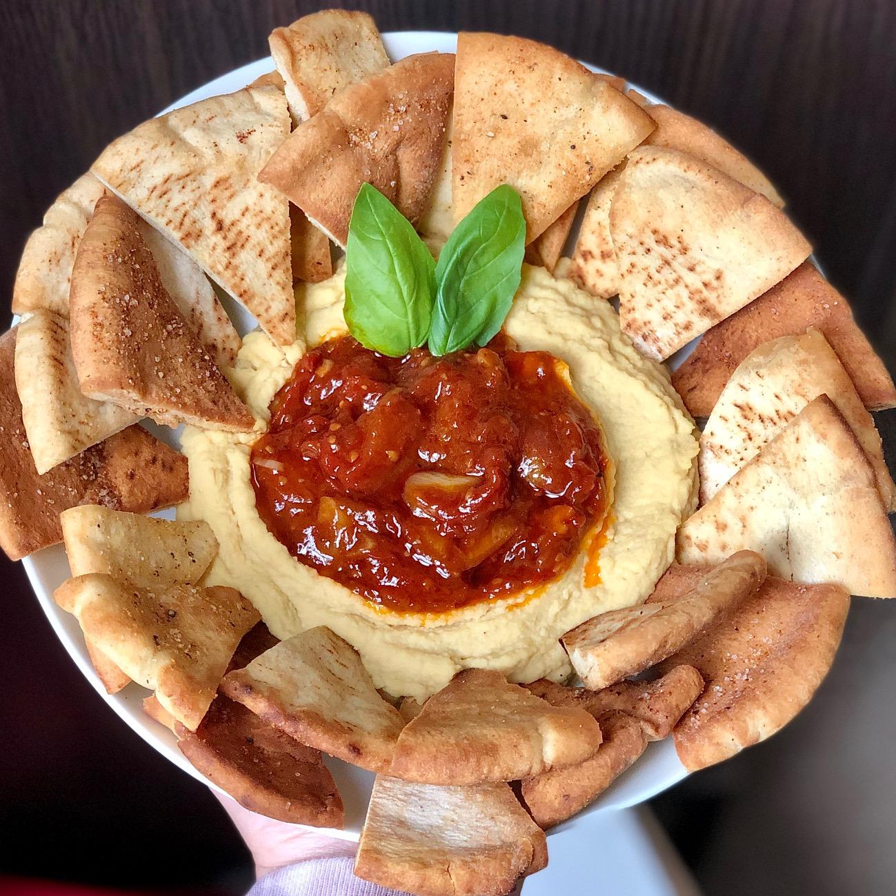 Hummus with balsamic tomato jam and pita chips