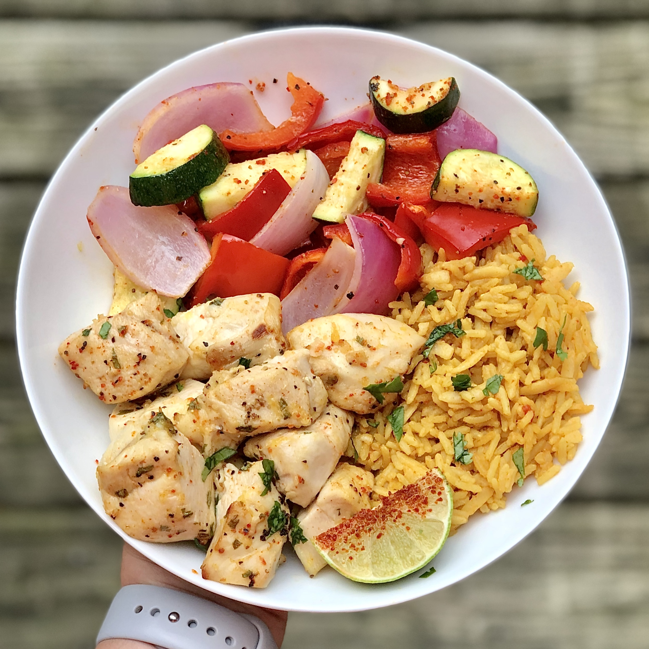 plate of chicken veggies and rice