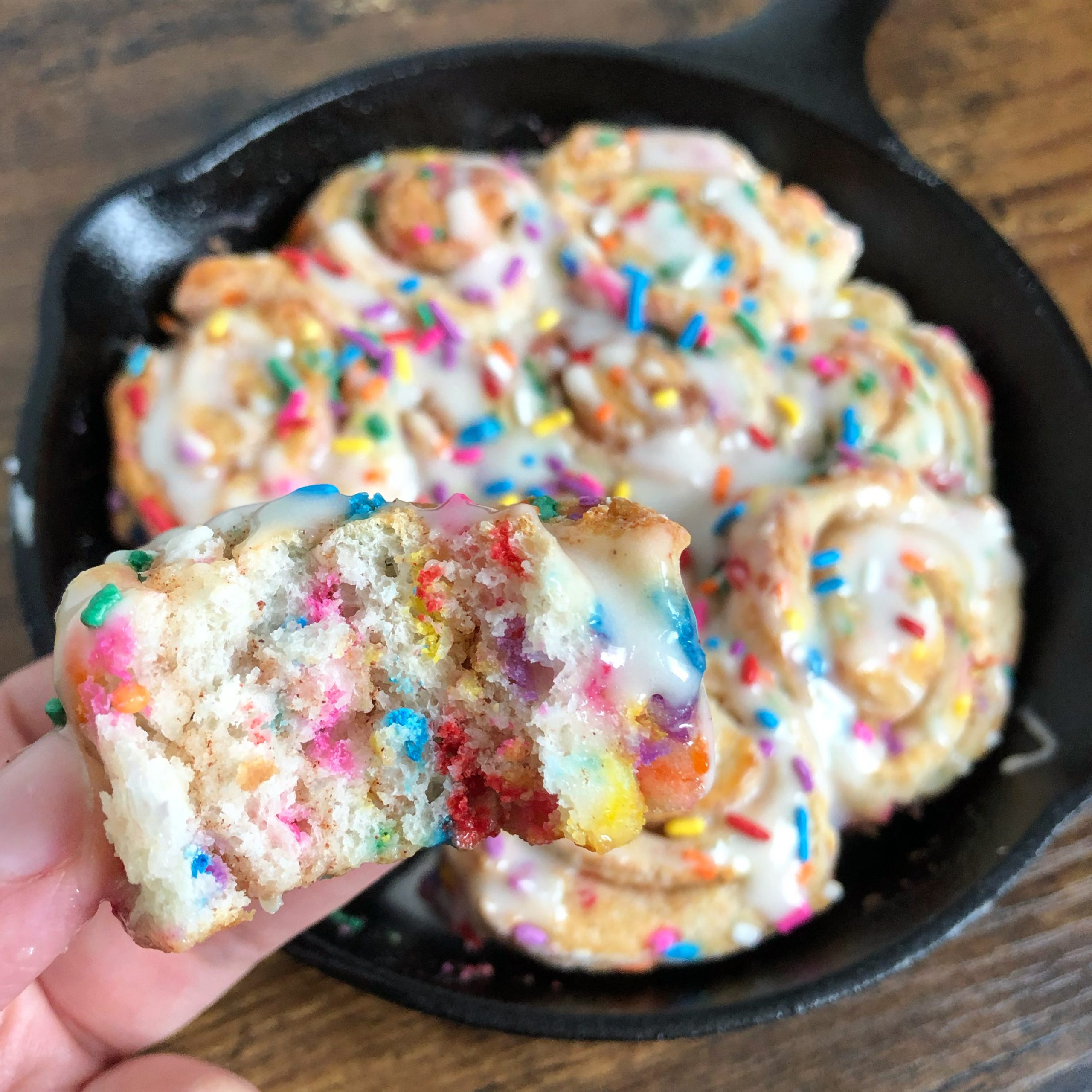 Close up of Funfetti Cinnamon Buns in a cast iron pan.