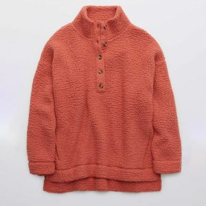 An Aerie Sherpa Oversized Pullover in rose.