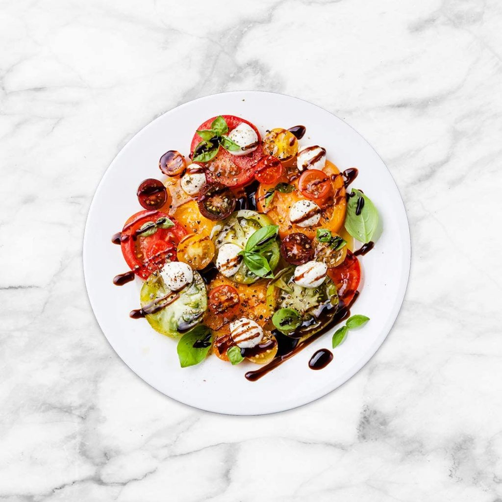 An Allenjoy Double Sided Photography Background with a caprese salad posed on it..
