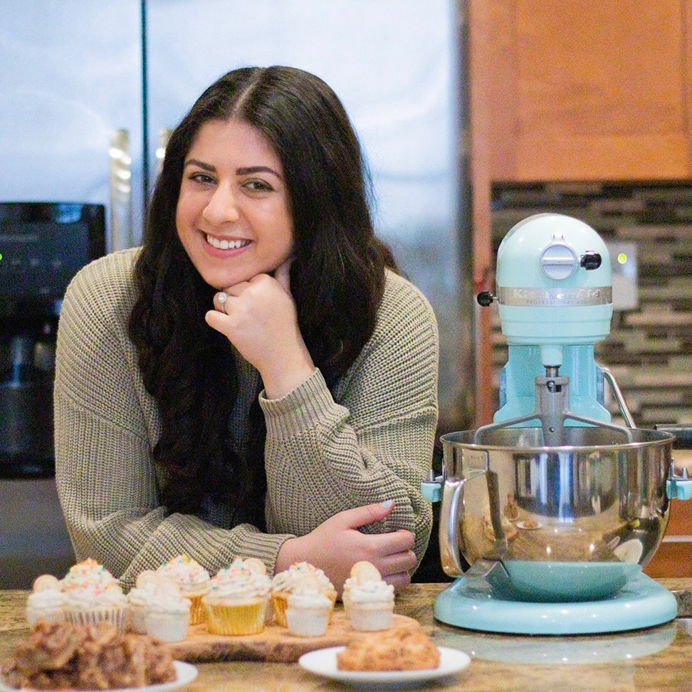 Jacklin posing with her baby blue Kitchenaid Professional Series Mixer.