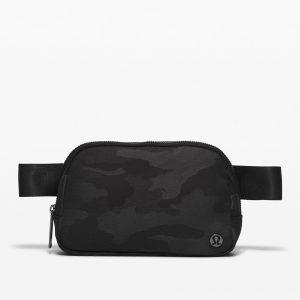 A Lululemon Everywhere Belt Bag in Black Camo.